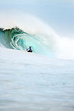 INDONESIA, Mentawai Islands, Kandui Resort, man surfing on a wave at Bankvaults