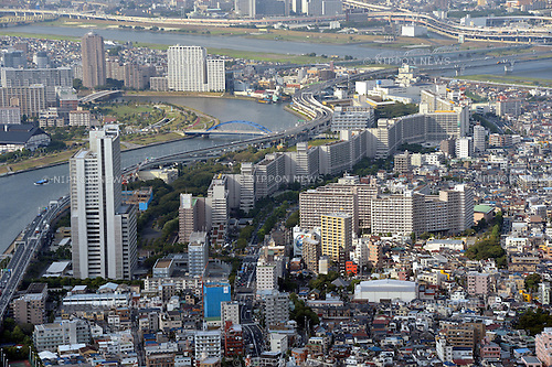 September 5, 2012, Tokyo, Japan - A cluster of decrepit houses stand side by side along narrow allies barely wide enough for fire engines to squeeze through in the densely populated Ichiterakototoi area of Tokyo's downtown Sumida ward on Wednesday, September 5, 2012. The row of apartment buildings along the Sumida River works as a fire wall in the event of disaster.. .In 1979, the district government led the country with its project to rebuild the areas crammed with wooden buildings to mitigate possible catastrophic fires. With only 40.7 percent of the areas made up of fire-resistant buildings and empty lots, the vast majority of the district, considered at high risk of fire and building collapse, could be burned to the ground if a catastrophic earthquake were to strike the nation's capital.  (Photo by Natsuki Sakai/AFLO) AYF -mis-