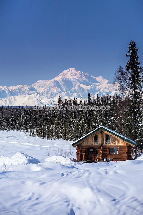 Log cabin with Mt. Mckinley and Alaska Range in the background.   Southcentral, Alaska<br /> <br />  PR2013-03-23SchorrJim Cabin