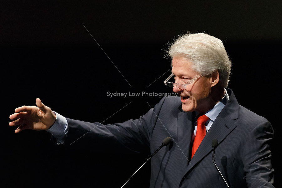 Former United States President Bill Clinton gestures towards protestors that disrupted his talk at the 20th International AIDS Conference (AIDS 2014) at the Melbourne Convention and Exhibition Centre on 23 July 2014.
