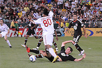 AC Milan forward Ronaldinho (80) tries to get by DC United midfielder Devon Mctavish (18) DC United defeated AC. Milan 3-2 at RFK Stadium, Wednesday May 26, 2010.