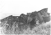 Wrecked rail cars piled next to track.<br /> RGS    9/1919