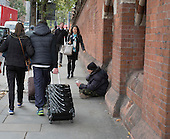 A homeless man begging on a street in Kings Cross London