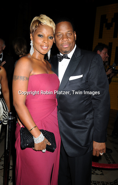 Mary J Blige in Gucci and husband Kendu Isaacs