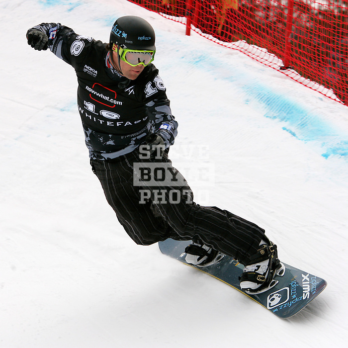 Nick Baumgartner (USA) competes in the qualification round for the Nokia Snowboard FIS World Cup for snowboard-cross at Whiteface Mountain in Lake Placid, New York on March 10, 2007.