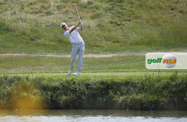 Michael Hoey (NIR) plays from the drop zone on the 16th during Round One of the 2015 Alstom Open de France, played at Le Golf National, Saint-Quentin-En-Yvelines, Paris, France. /02/07/2015/. Picture: Golffile | David Lloyd<br /> <br /> All photos usage must carry mandatory copyright credit (&copy; Golffile | David Lloyd)