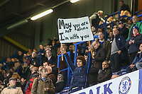 A lone Chelsea fan holds up a sign of support for Jose Mourinho (Manager) of Chelsea that reads 'MOU you are not alone I'm with you' during the UEFA Champions League group match between Chelsea and FC Porto at Stamford Bridge, London, England on 9 December 2015. Photo by David Horn / PRiME