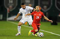 Washington, D.C.- May 29, 2014. Turkey defender Tarik Camdal gets fouled by Honduras defender Emilio Izaguirre.  Turkey defeated Honduras 2-0 during an international friendly game at RFK Stadium.