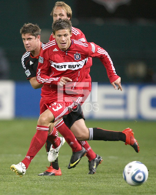 Devon McTavish of D.C. United comes up behind Krzysztof Krol #23 of the Chicago Fire during an MLS match on April 17 2010, at RFK Stadium in Washington D.C.Fire won 2-0.