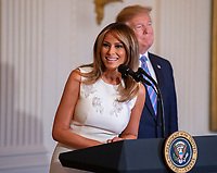United States President Donald J. Trump and First lady Melania Trump participate in the Celebration of Military Mothers in the East Room of the White House in Washington, DC on May 10, 2019.<br /> CAP/MPI/RS<br /> &copy;RS/MPI/Capital Pictures