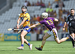 Ian Galvin of Clare in action against David Dunne of Wexford during their All-Ireland quarter final at Pairc Ui Chaoimh. Photograph by John Kelly.