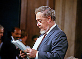 Judge Robert H. Bork, United States President Ronald Reagan's nominee for Associate Justice of the U.S. Supreme Court, reads over some documents during a break in his testimony before the U.S. Senate Judiciary Committee during his confirmation hearing on September 17, 1987.  Bork passed away on December 19, 2012..Credit: Howard L. Sachs / CNP