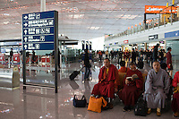 Buddhist monks in Terminal Three of Beijing Capital International Airport, China