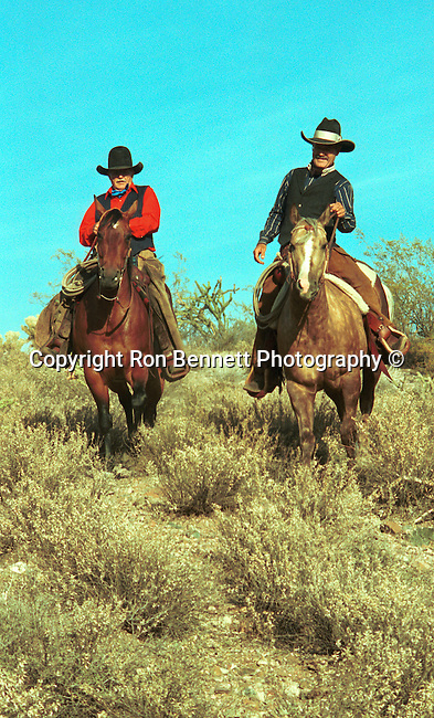 Ol' cowboys, cowboys ride Tommy and Carson Thomas ride in desert, Carson Thomas, Tommy Thomas, cowboy, Cowboys on horse back, animal herder, ranches, wrangler, rodeos, Arizona, State of Arizona, Southwest, desert, 48th State, Last of contiguous states, Phoenix, Scottsdale, Grand Canyon, Indian reservations, four corners, desert landscape, exrophyte, western United States, Southwest, Mountains, plateaus, ponderosa pines, Colorado River,  Mountain lion, Navajo Nation, No daylight savings time, Arizona Territory, Arizona, Fine Art Photography by Ron Bennett, Fine Art, Fine Art photography, Art Photography, Copyright RonBennettPhotography.com ©