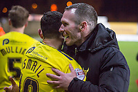 Michael Appleton Manager of Oxford United embraces loanee Zeli Ismail of Oxford United during the Johnstone's Paint Trophy Southern Final 2nd Leg match between Oxford United and Millwall at the Kassam Stadium, Oxford, England on 2 February 2016. Photo by Andy Rowland / PRiME Media Images.