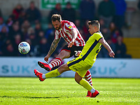 Lincoln City's Neal Eardley clears under pressure from  Cheltenham Town's Billy Waters<br /> <br /> Photographer Andrew Vaughan/CameraSport<br /> <br /> The EFL Sky Bet League Two - Lincoln City v Cheltenham Town - Saturday 13th April 2019 - Sincil Bank - Lincoln<br /> <br /> World Copyright &copy; 2019 CameraSport. All rights reserved. 43 Linden Ave. Countesthorpe. Leicester. England. LE8 5PG - Tel: +44 (0) 116 277 4147 - admin@camerasport.com - www.camerasport.com