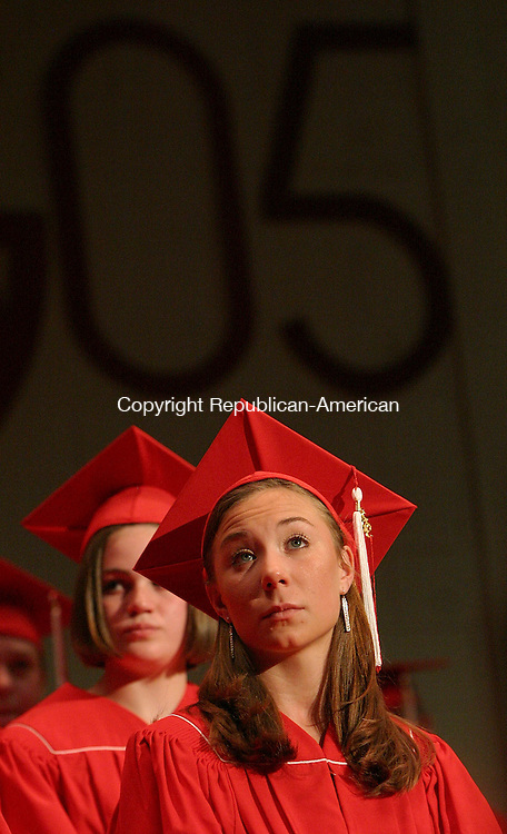 LITCHFIELD, CT -17 June 2004- 061705BZ04- Kristy Dwyer, 18, of Morris, foreground, sits pensively during commencement excercise at Wamogo High Friday night.<br /> Jamison C. Bazinet photo