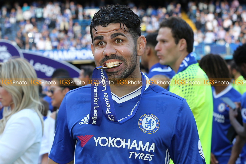 Chelsea's Diego Costa celebrates after the match as he bites on his Premier League medal during Chelsea vs Sunderland AFC, Premier League Football at Stamford Bridge on 21st May 2017