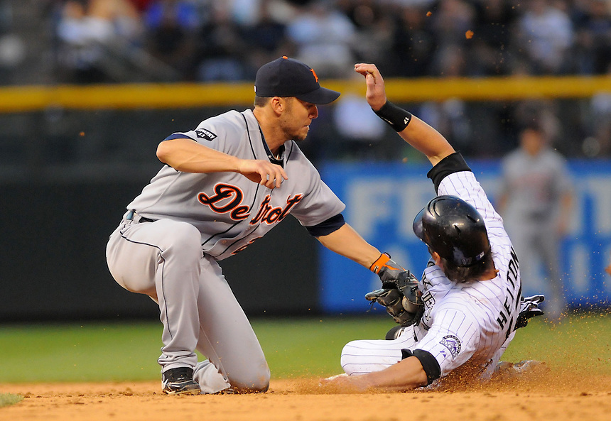 18 JUNE 2011: Detroit Tigers left fielder Ryan Raburn (25) tags out Colorado Rockies first baseman Todd Helton (17) on a failed hit and run during a regular season interleage game between the Detroit Tigers and the Colorado Rockies at Coors Field in Denver, Colorado. The Rockies beat the Tigers 5-4.   *****For Editorial Use Only*****
