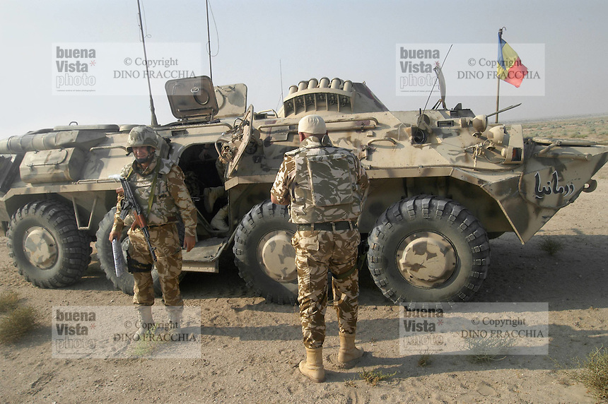 "- soldiers of 812th  battalion ""Hawks of the Balkans"" of the Rumanian army in service in Iraq,  province of Dhi Qar,  under the Italian command, Russian built armoured vehicles ....- militari dell'812° battaglione ""Falchi dei Balcani"" dell'esercito romeno in servizio in Iraq nella provincia di Dhi Qar sotto il comando italiano, veicoli blindati di costruzione russa"