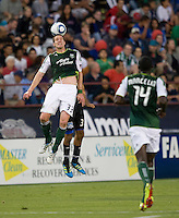 Kenny Cooper of Timbers controls the ball in the air during the game against the Earthquakes at Buck Shaw Stadium in Santa Clara, California on August 6th, 2011.   San Jose Earthquakes and Portland Timbers tied 1-1.