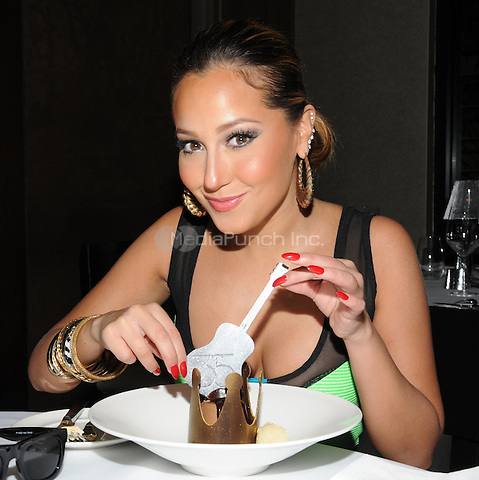 Adrienne Bailon enjoys the King of Desserts at 35 Steaks & Martinis at the Hard Rock Hotel for her 28th birthday celebration in Las Vegas, NV. November 11, 2011 Erik Kabik / MediaPunch.