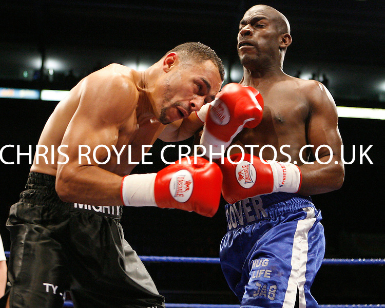 November 9th 2007 - Tyrone Wright (L) and Simeon Cover trade blows during their bout at the Ice Arena, Nottingham, England