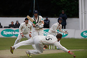June 11th 2017, Trafalgar Road Ground, Southport, England; Specsavers County Championship Division One; Day Three; Lancashire versus Middlesex; Stephen Croft of Lancashire dives to stop a drive from James Harris; Lancashire were all out for 309 after lunch in reply to Middlesex's first innings score of 180 all out