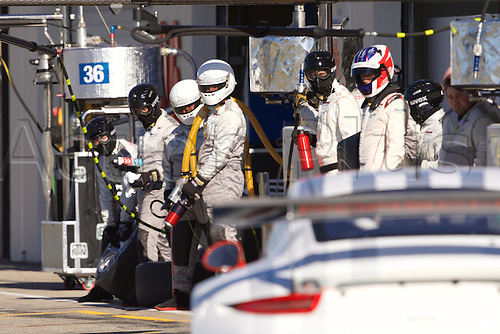 28.03.2015.  Le Castellet, France. World Endurance Championship Prologue Day 2. The Porsche Team Manthey pit crew await their car.