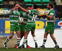 Manawatu first five Aaron Cruden (second right) congratulates Andre Taylor (left) on his second try along with Johnny Leota and Casey Stone (right) during the Air NZ Cup preseason match between Manawatu Turbos and Wellington Lions at FMG Stadium, Palmerston North, New Zealand on Friday, 17 July 2009. Photo: Dave Lintott / lintottphoto.co.nz