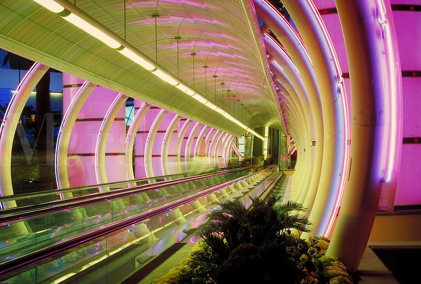 entrance tunnel to Bally's casino lit with brightly colored neon lights. Las Vegas Nevada USA.