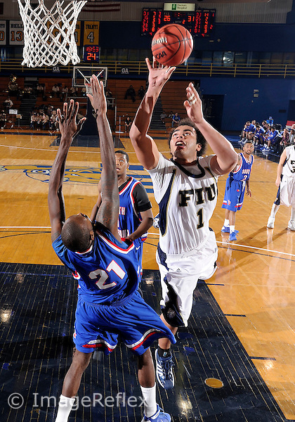 Florida International University men's basketball center/forward Freddy Asprilla (1) plays against the University of South Alabama.  FIU won the game 50-46 on December 20, 2008 at Miami, Florida. .