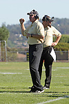 Palos Verdes, CA 10/08/10 - Caoch Kevin Moen and Coach Adam Boyd in action during the South Torrance Spartans vs Peninsula Panthers Varsity football game at Palos Verdes Peninsula High School.