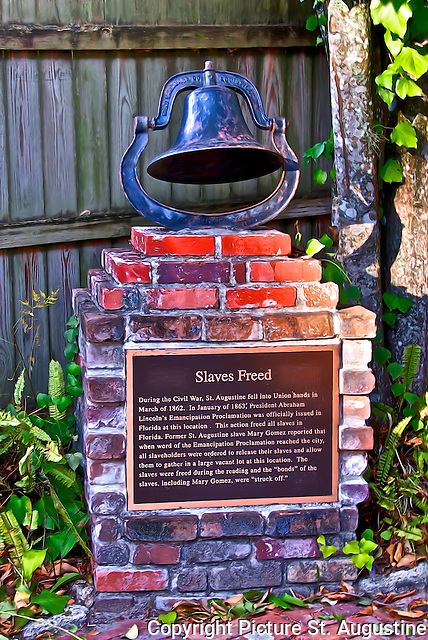 "A Bell on top of a marker commemorating ""Slaves Freed"". Former St. Augustine slave Mary Gomez reported in an early 20th century St. Augustine newspaper article that when word of the Emancipation Proclamation reached the city, all slaveholders were ordered to release their slaves and allow them to gather in a large vacant lot at the location where the proclamation was to be read. The slaves were freed during the reading and the ''bonds'' of the slaves, including Mary Gomez, were ''struck off.''"