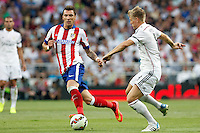 Toni Kroos of Real Madrid and Manzukic of Atletico de Madrid during La Liga match between Real Madrid and Atletico de Madrid at Santiago Bernabeu stadium in Madrid, Spain. September 13, 2014. (ALTERPHOTOS/Caro Marin)