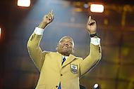 Canton, Ohio - August 1, 2014: Aeneas Williams shows gratitude after donning his gold jacket during the Pro Football Hall of Fame's class of 2014 enshrinement dinner in Canton, Ohio  August 1, 2014. During his career, Williams had nine interceptions returned for a touchdown and was named to eight Pro Bowl teams.  (Photo by Don Baxter/Media Images International)