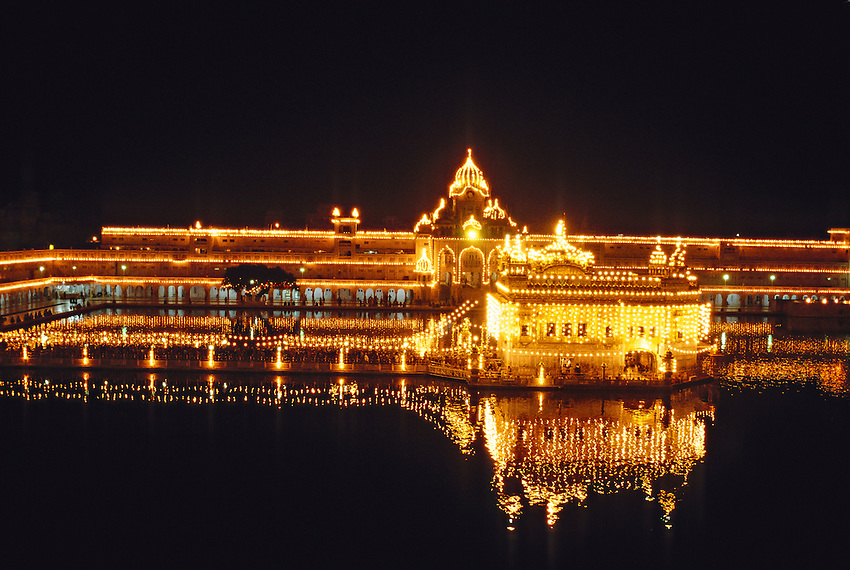 The Golden Temple (holiest Sikh shrine) illuminated at night, Amritsar, Punjab, India
