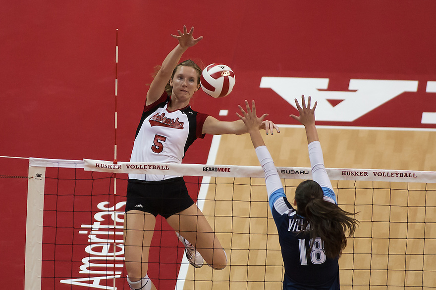 September 6, 2013:  In the second set Amber Rolfzen #5 of the Nebraska Cornhuskers spikes the ball against Lauren Carpenter #18 of the Villanova Wildcats at the Devaney Sports Center in Lincoln, Nebraska. Nebraska defeated Villanova three sets to one.