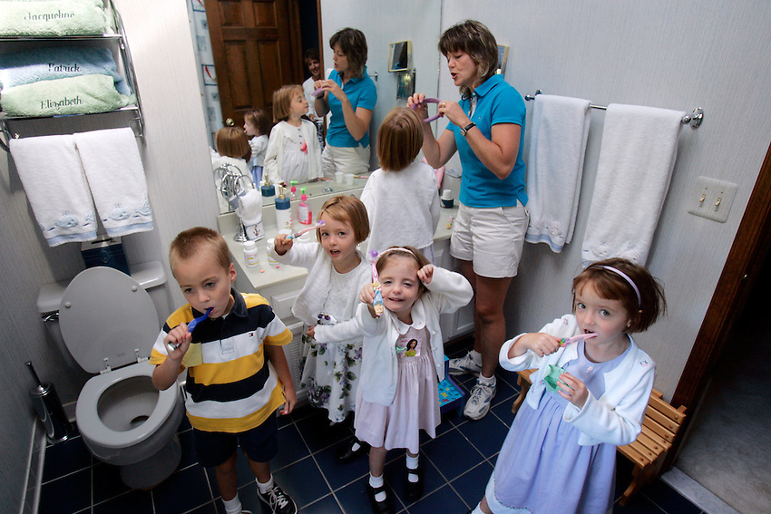 20060912AM  --1/* -- CORRECT CAPTION INFO!!!  The Keogh quints are now five years old and have started school. Here they are brushing their teeth as they get ready for school: Mom (Susan Keogh) fixes the hair of Meghan. Standing: Patrick, Elizabeth, Brigid and Jacqueline.  DOVER TOWNSHIP, NJ  9/12/06  10:57:36 AM  ANDREW MILLS/THE STAR-LEDGER..
