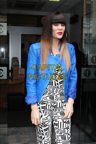 Jessie J (Jessica Ellen Cornish) at BBC Radio 1, London, England..May 31st, 2012.half length black white print jumpsuit blue blazer jacket eyes closed blinking funny dyed hair blonde fringe bangs hair   .CAP/HIL.©John Hillcoat/Capital Pictures.