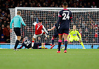 Alexis Sanchez of Arsenal has a shot on goal blocked during the Premier League match between Arsenal and Huddersfield Town at the Emirates Stadium, London, England on 29 November 2017. Photo by Carlton Myrie / PRiME Media Images.