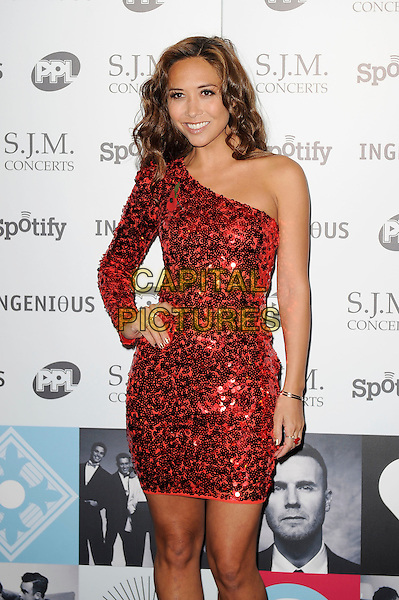 Myleene Klass.Attending the Music Industry Trusts Award, Grosvenor House, London, England..5th November 2012.MITS half length red one shoulder sleeve dress sequins sequined hand on hip.CAP/MAR.© Martin Harris/Capital Pictures.