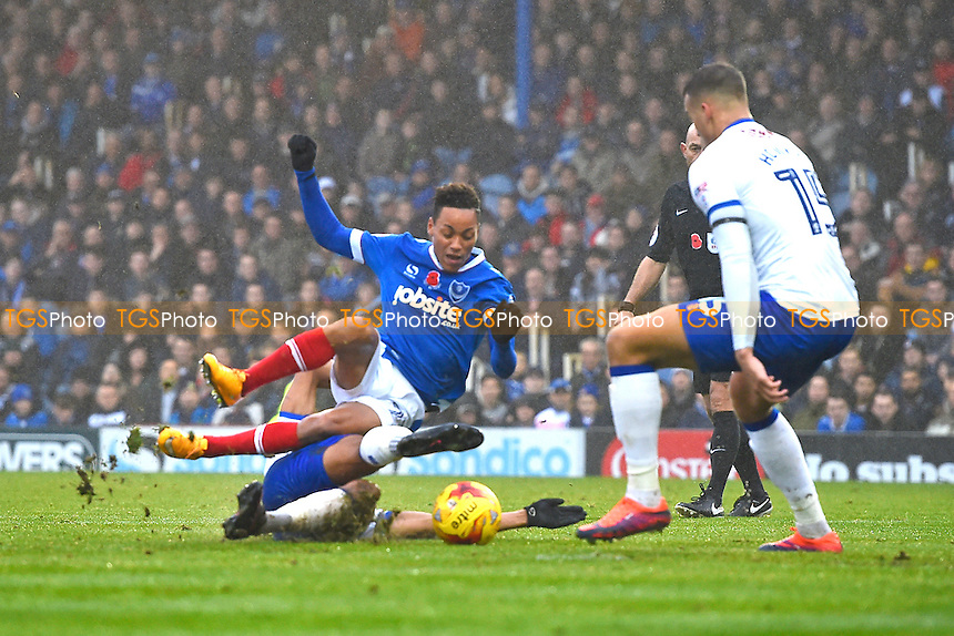 Kyle Bennett of Portsmouth is fouled and a penalty given by Referee Roger East during Portsmouth vs Mansfield Town, Sky Bet EFL League 2 Football at Fratton Park on 12th November 2016