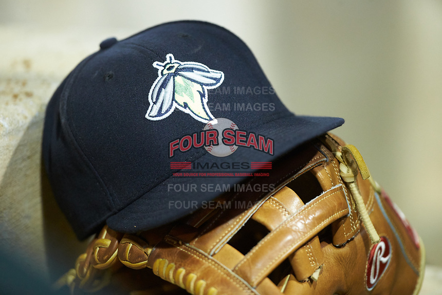 A Columbia Fireflies cap sits on top of a Rawlings baseball glove during the game against the Charleston RiverDogs at Spirit Communications Park on June 9, 2017 in Columbia, South Carolina.  The Fireflies defeated the RiverDogs 3-1.  (Brian Westerholt/Four Seam Images)