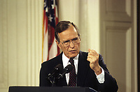 ***FILE PHOTO*** George H.W. Bush Has Passed Away<br /> Washington DC., USA, June 4,1992<br /> President George H.W. Bush answers reporters questions. This was after his meeting with Prime Minister Eugenia Charles and Other Eastern Caribbean leaders during an official visit of those leaders to the White House. <br /> CAP/MPI/MRN<br /> &copy;MRN/MPI/Capital Pictures