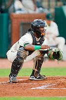 Catcher Carlos Paulino #1 of the Greensboro Grasshoppers at NewBridge Bank Park July 30, 2010, in Greensboro, North Carolina.  Photo by Brian Westerholt / Four Seam Images