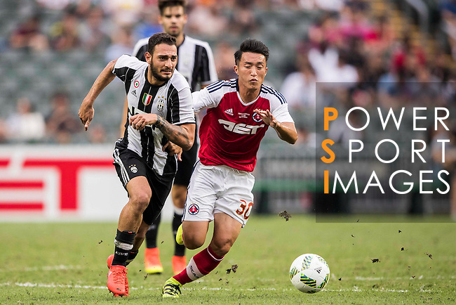 Juventus' player Grigoris Kastanos battles South China's player Chu Siu Kei for the ball during the South China vs Juventus match of the AET International Challenge Cup on 30 July 2016 at Hong Kong Stadium, in Hong Kong, China.  Photo by Marcio Machado / Power Sport Images