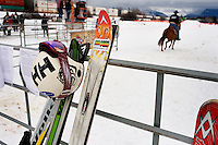 Competitors' ski equipment and ropes stand by the arena at the Whitefish Skijoring World Championship event in Whitefish, Montana, USA.  Skijoring is a competitive sport in which a person on skis navigates an obstacle course while being pulled behind a galloping horse.