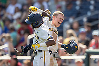 Michigan Wolverines first baseman Jimmy Kerr (15) celebrates with teammate Christian Bullock (5) after hitting a home run during Game 11 of the NCAA College World Series against the Texas Tech Red Raiders on June 21, 2019 at TD Ameritrade Park in Omaha, Nebraska. Michigan defeated Texas Tech 15-3 and is headed to the CWS Finals. (Andrew Woolley/Four Seam Images)