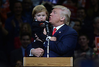 WILKES-BARR, PA - OCTOBER 10: Republican Presidential candidate Donald Trump speaks while holding 2 year-old Hunter Tirpak during a campaign appearance at the Mohegan Sun Arena in Wilkes-Barre, Pa on October 10, 2016. Credit: Dennis Van Tine/MediaPunch